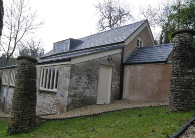 A once derelict former Coach House within the grounds of a listed building now restored and converted into a live/ work unit for a local sculptor.