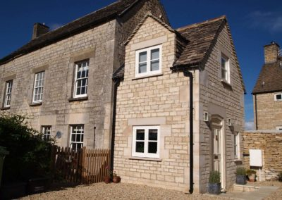Traditional stone extension of a cottage in Avening to provide basement, entrance hall, and first floor study